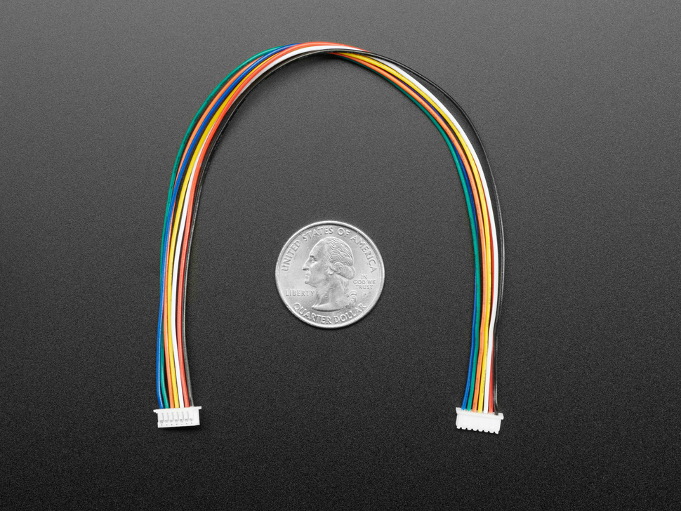 20cm long 1.25mm pitch 8-pin cable above US quarter.