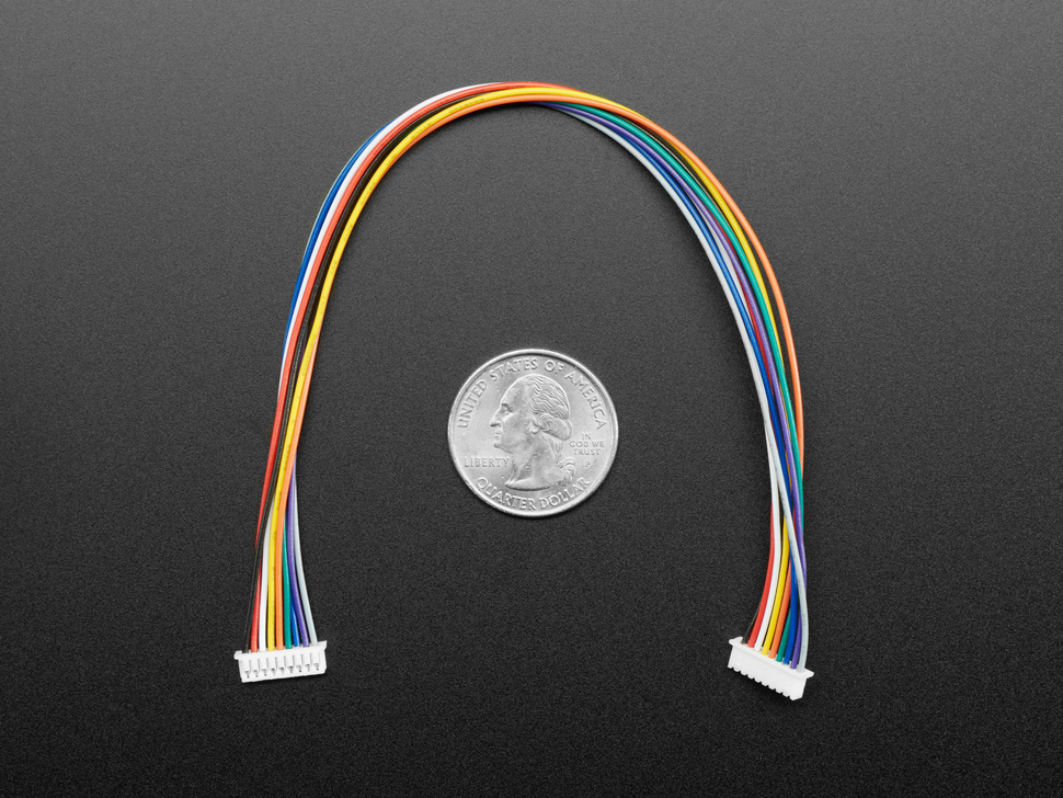 20cm long 1.25mm pitch 9-pin cable above US quarter.