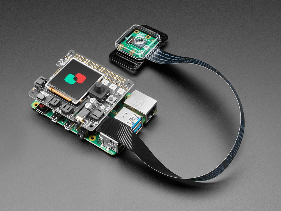Angled shot of assembled BrainCraft HAT with Raspberry Pi Camera and long FPC ribbon cable