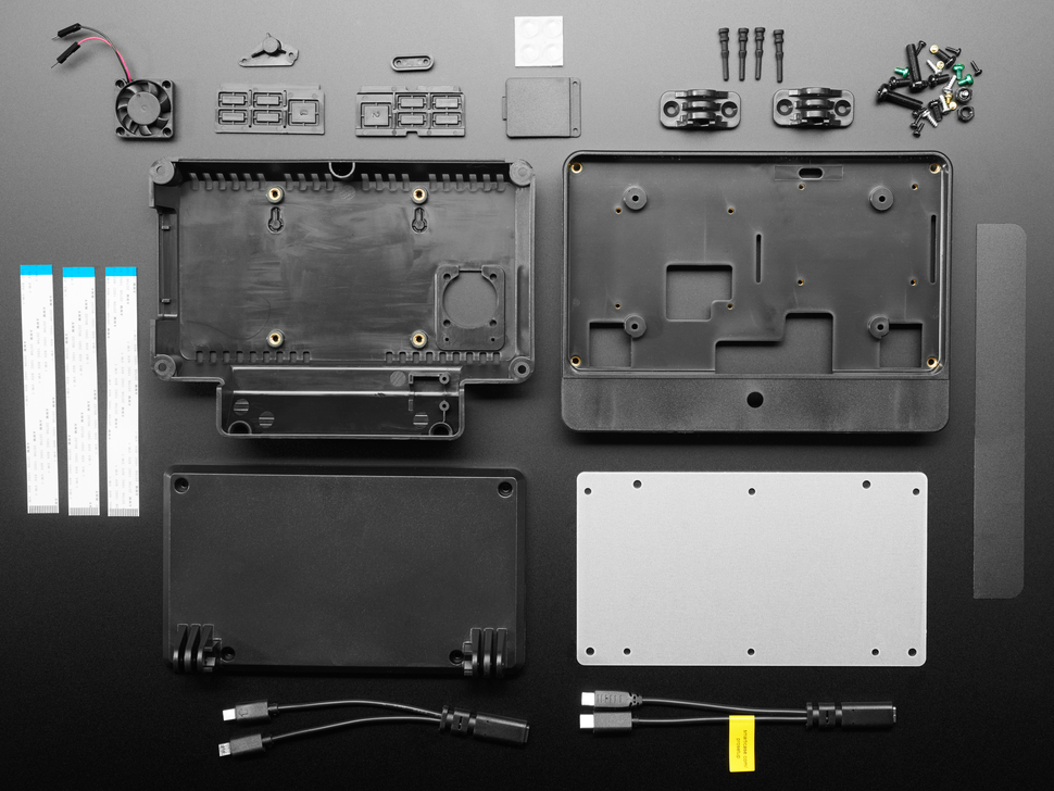 Topdown shot of various enclosure pieces, along with hardware and screws.