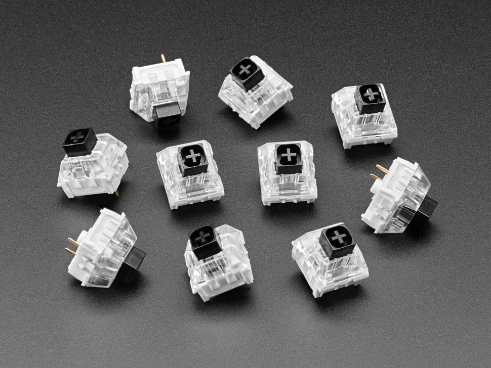 Angled shot of ten black Kailh key switches.