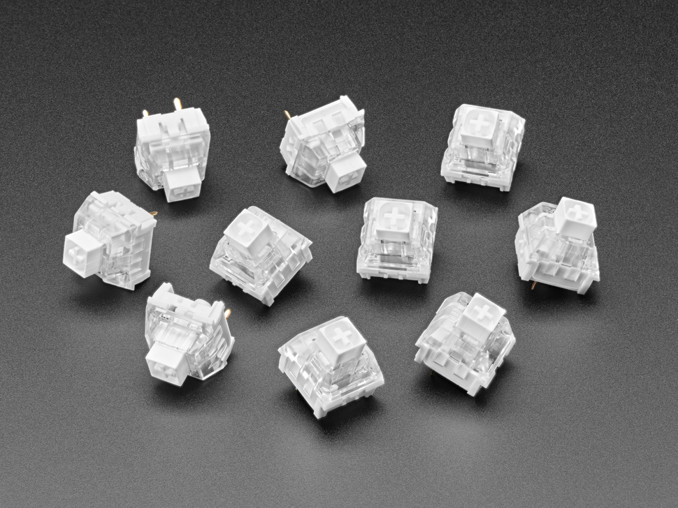 Angled shot of ten white Kailh key switches.