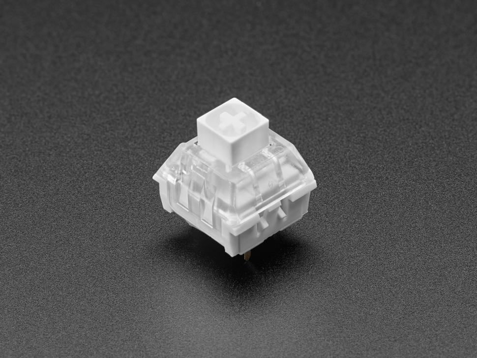 Angled shot of single white Kailh key switch.