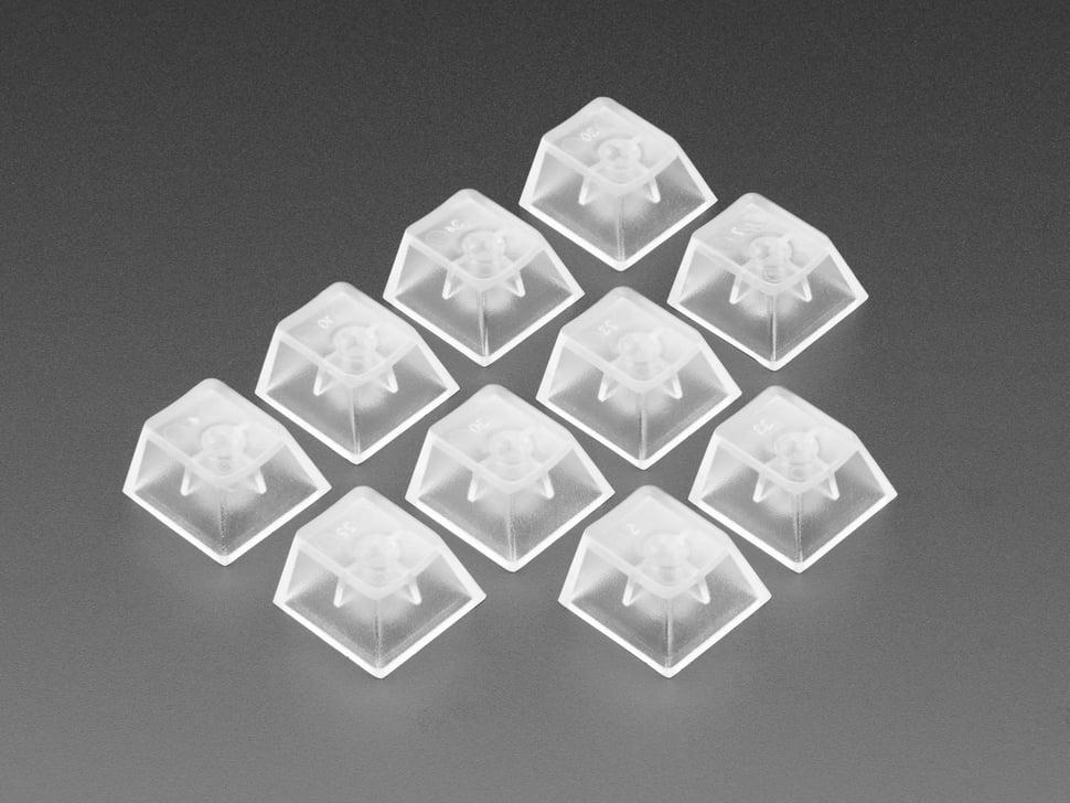 Angled shot of 10 translucent key caps.