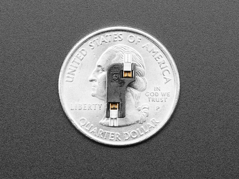 Single Kailh switch socket atop a US quarter.