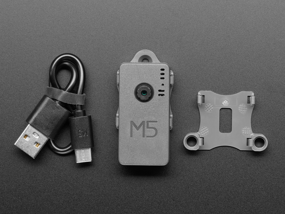 M5Stack camera between a USB-C cable and plastic enclosure.
