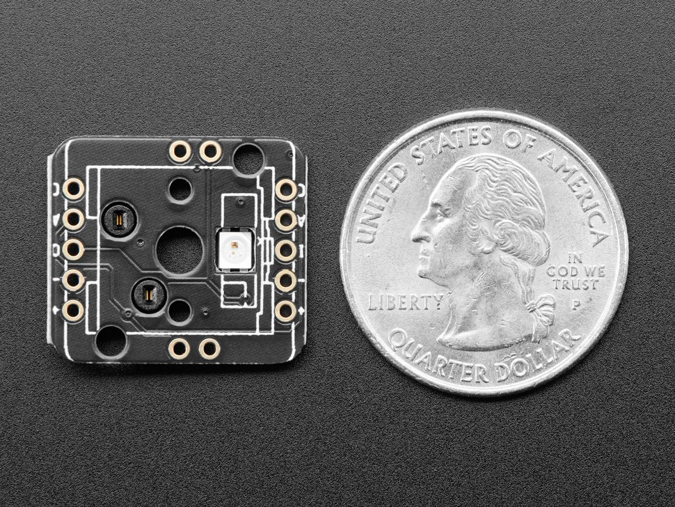 Bottom of socket breakout PCB next to US quarter for scale.