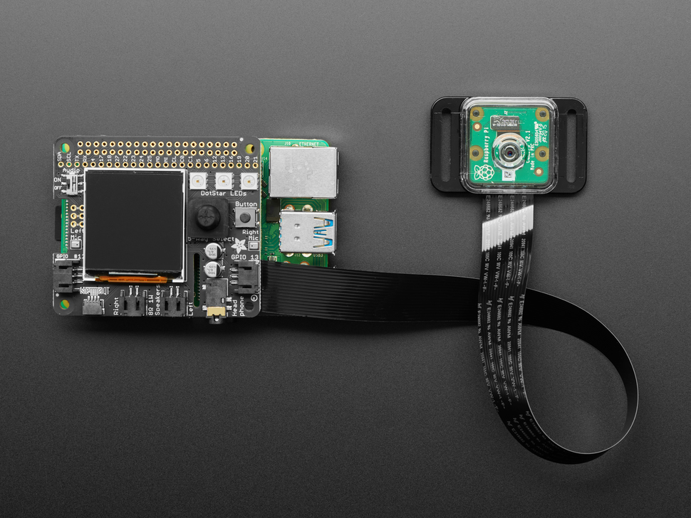 Assembled BrainCraft HAT with Raspberry Pi Camera and long FPC ribbon cable.
