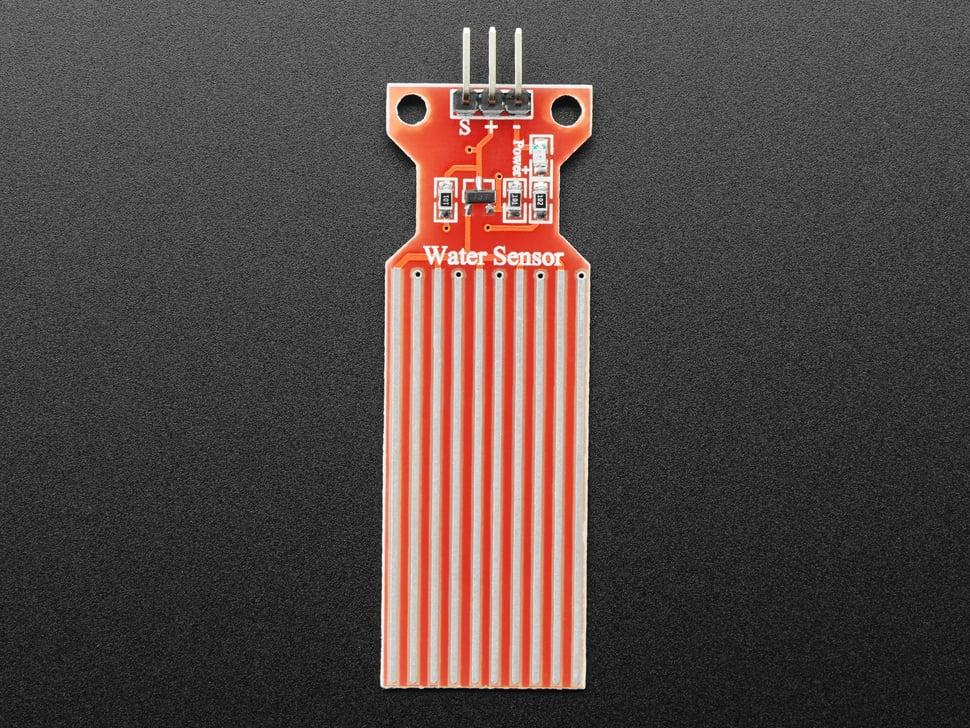 Top-down shot of red water sensor.
