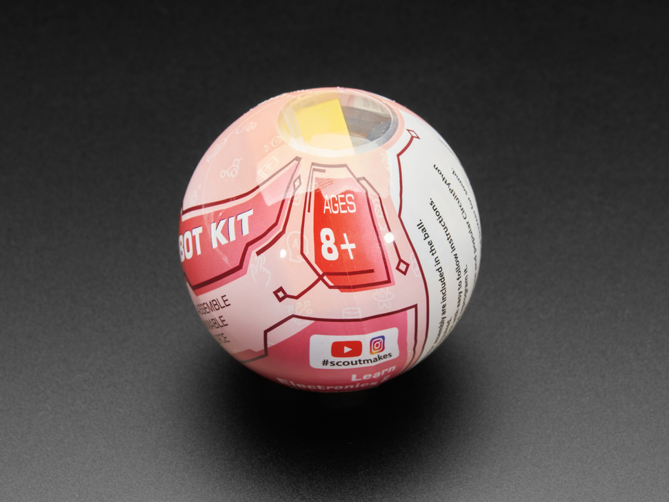 """Close-up of round ball packaging. The text: """"Ages 8+"""" is visible."""