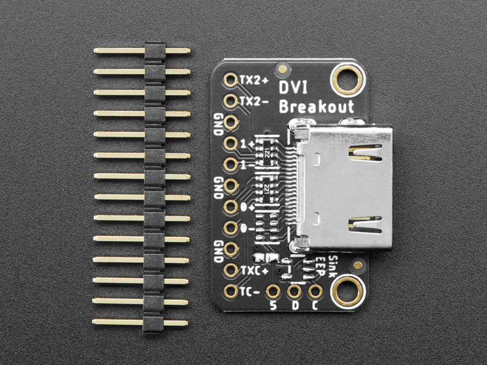 "DVI breakout board next to 16-pin male 0.1"" header."
