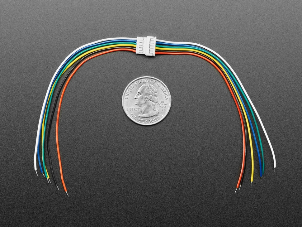 Top view of two 20cm long 6-pin matching cables connected above a US quarter for scale.