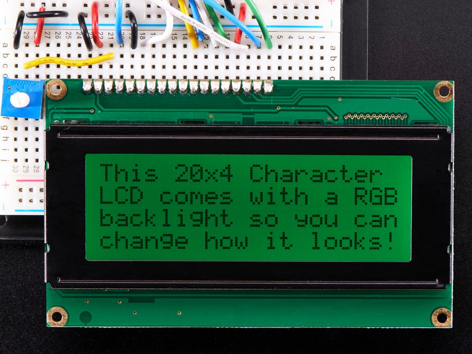 "LCD wired on breadboard with text displayed: ""This 20x4 Character LCD comes with an RGB backlight so you can change how it looks"" with green backlight"