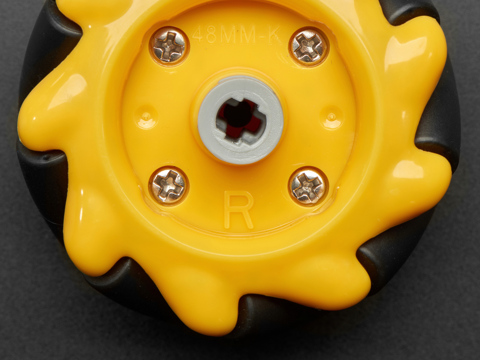 Close-up of R embossed on right mecanum wheel.
