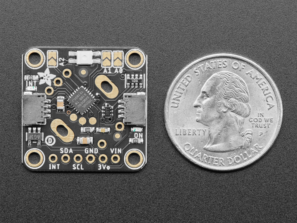 Bottom of rotary breakout board next to US quarter for scale.