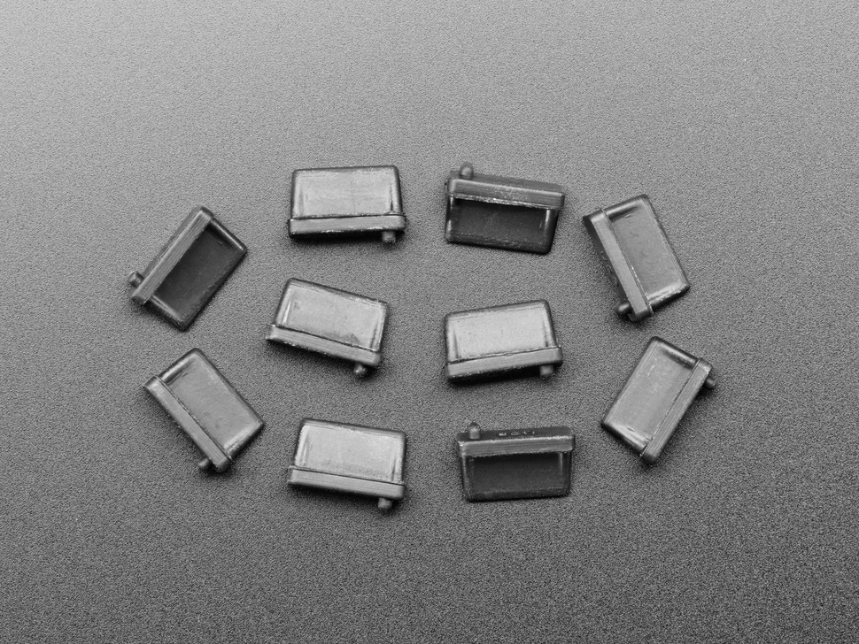 Top view of 10 black silicone USB A covers.
