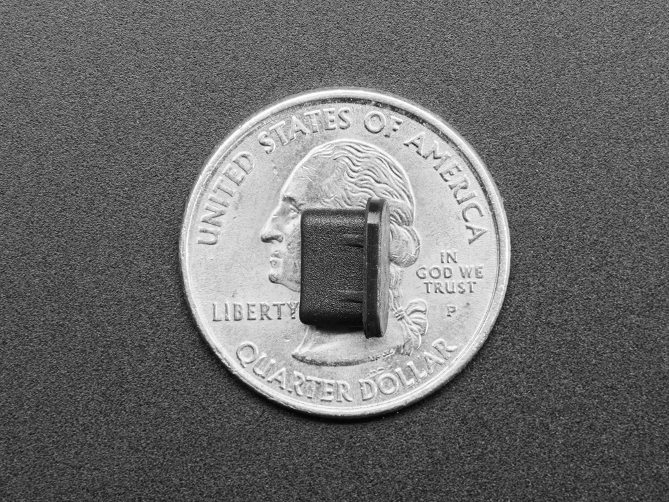 Silicone USB C insert measured by a US quarter