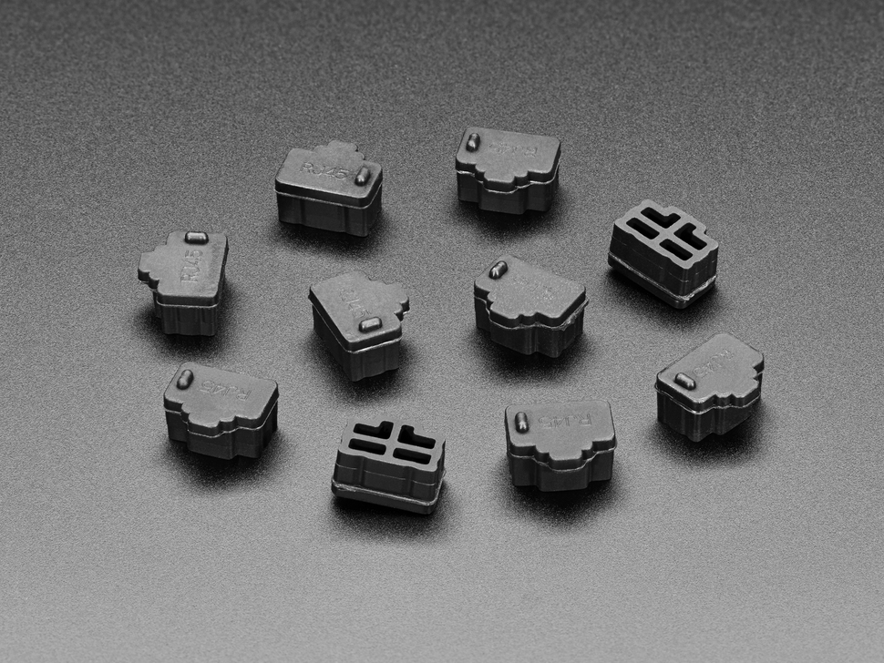Angled shot of 10 black silicone RJ-45 covers.