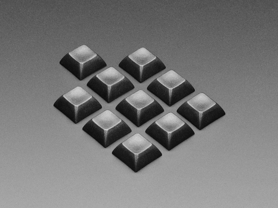 Angled shot of 10 black keycaps.