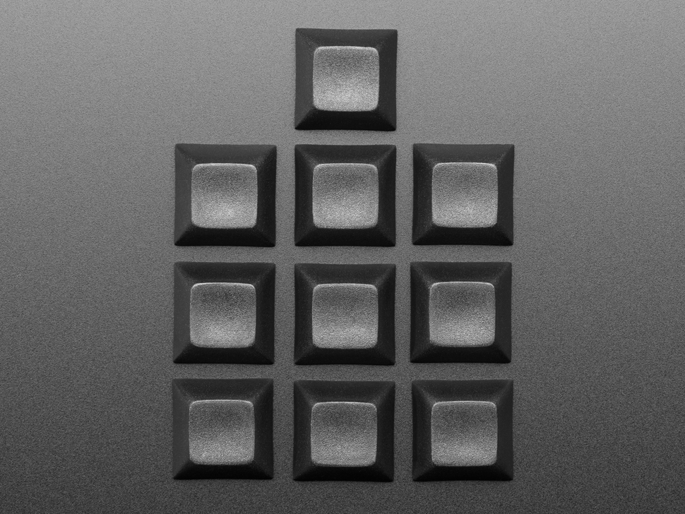 Top view of 10 black keycaps.