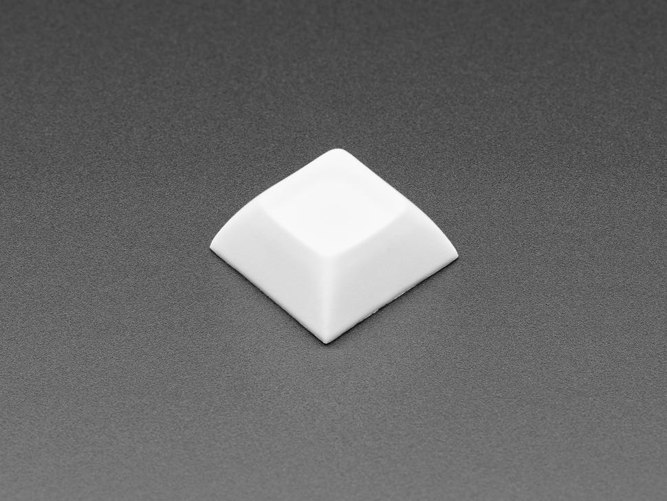 Single white plastic keycap.