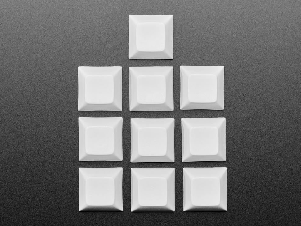 Top view of 10 plastic gray keycaps