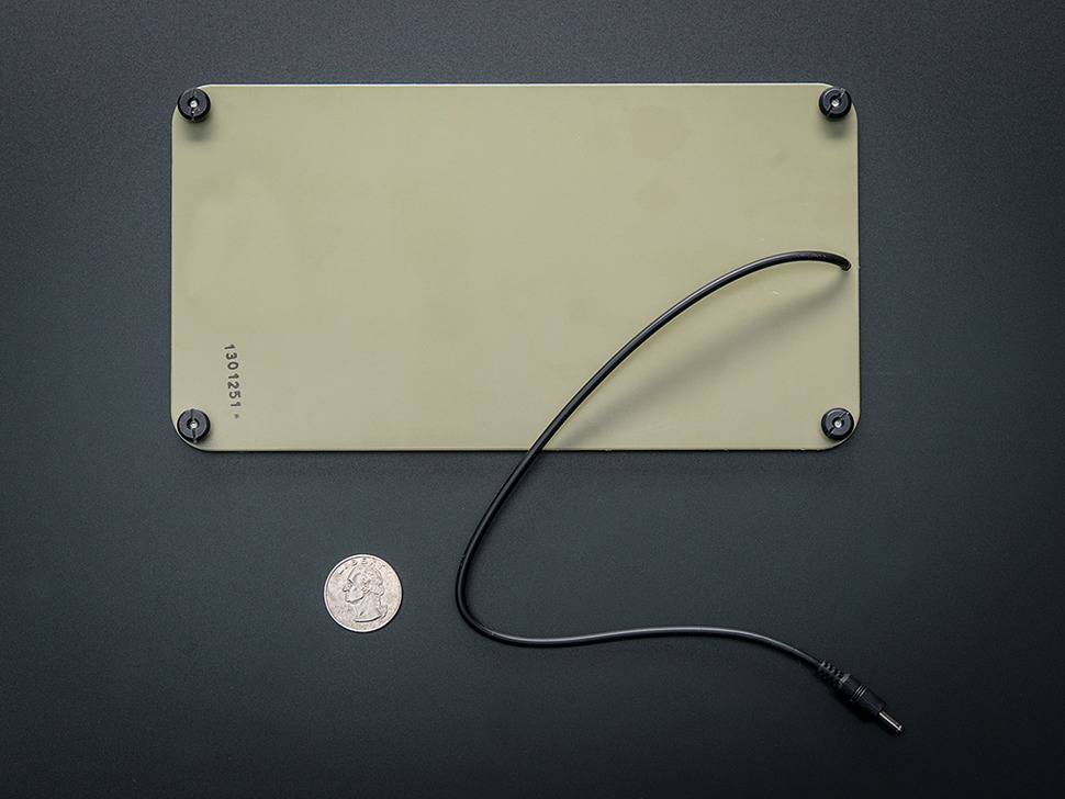 Back of Panel with mounting nubs, next to quarter