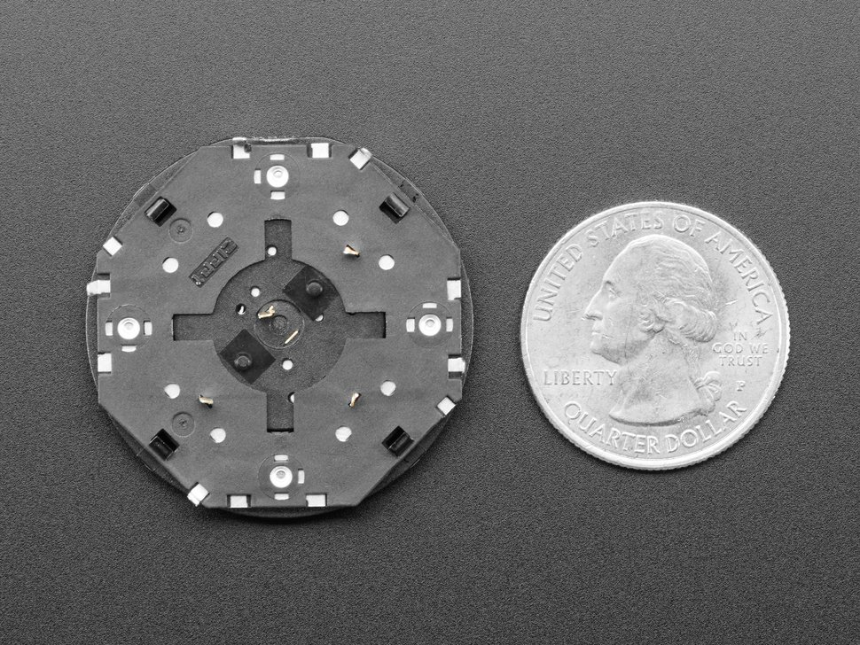 Bottom of ANM rotary encoder next ot US quater for scale.