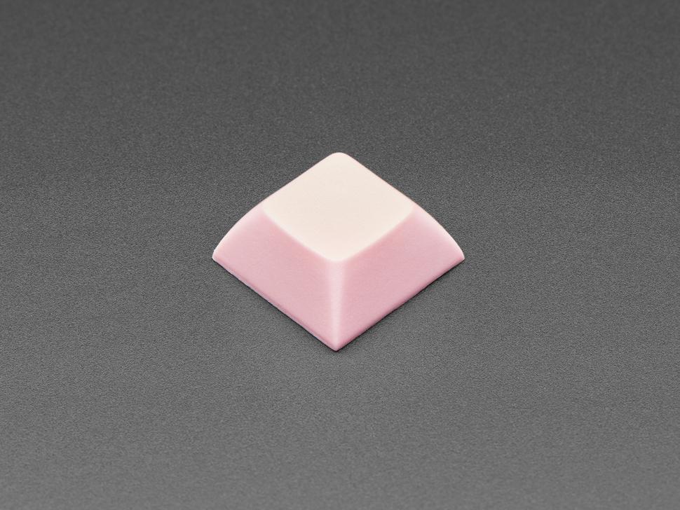 Single pink plastic keycap.
