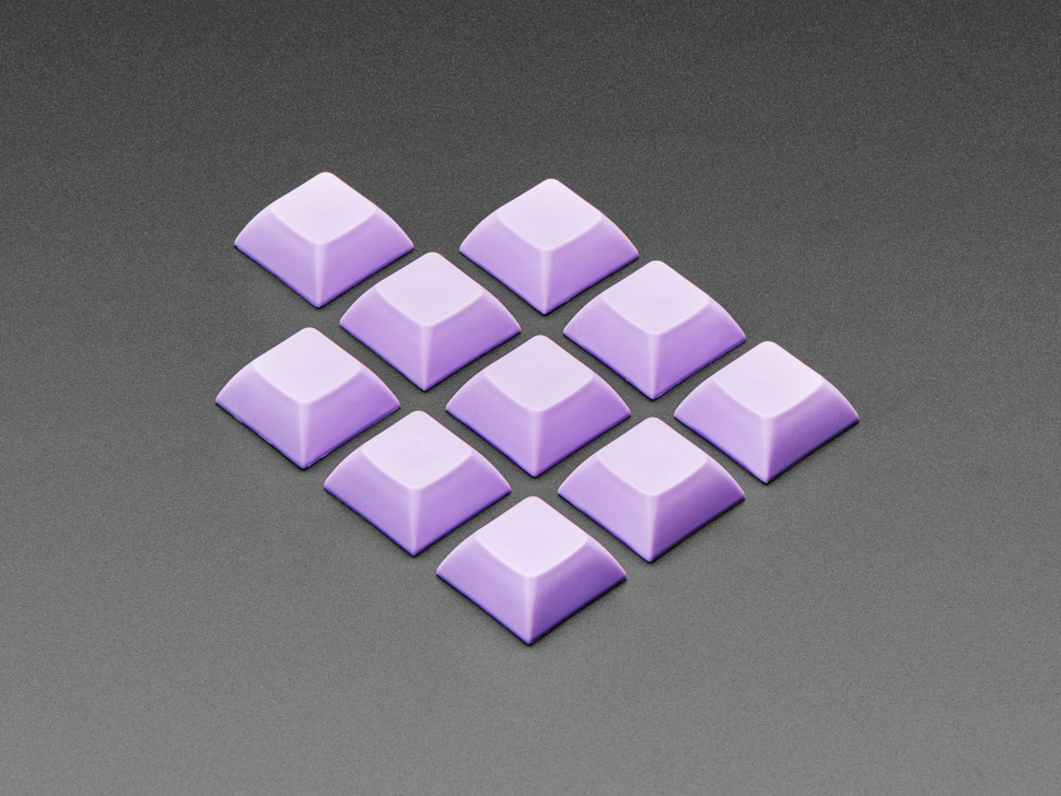 Angled shot of 10 lavender plastic keycaps.