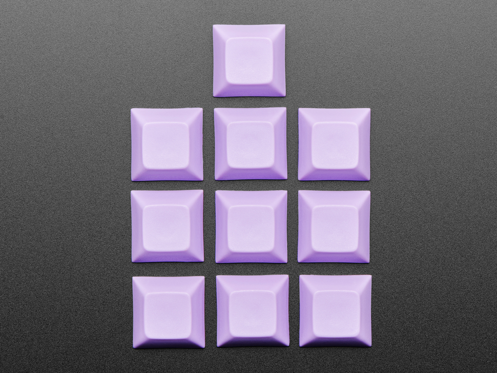 Top view of 10 lavender plastic keycaps.