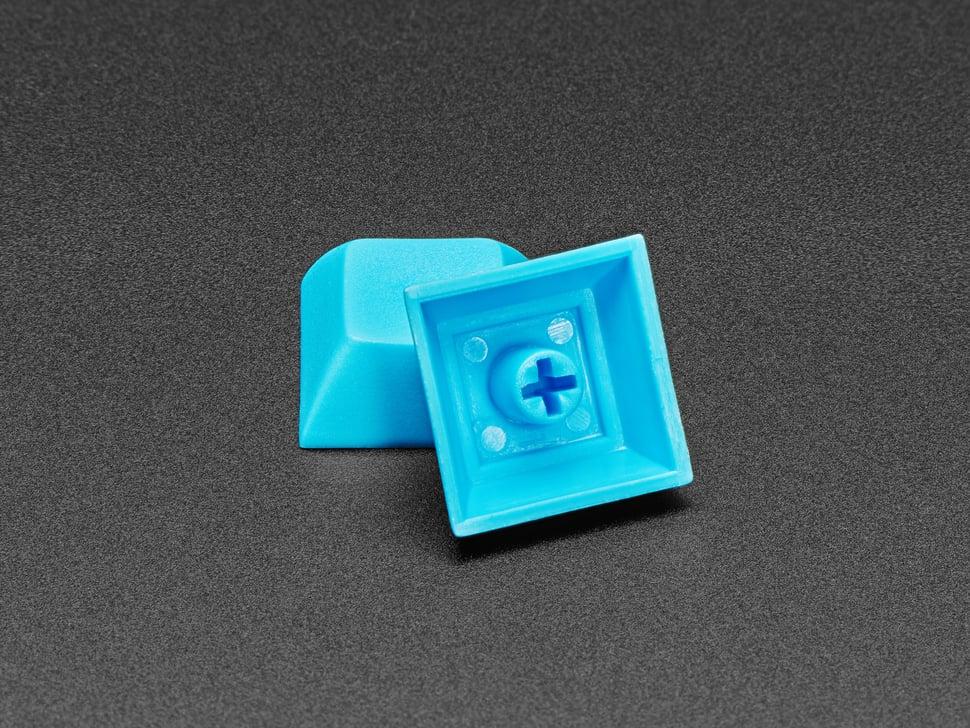 Detail of bottom of light blue DSA caps