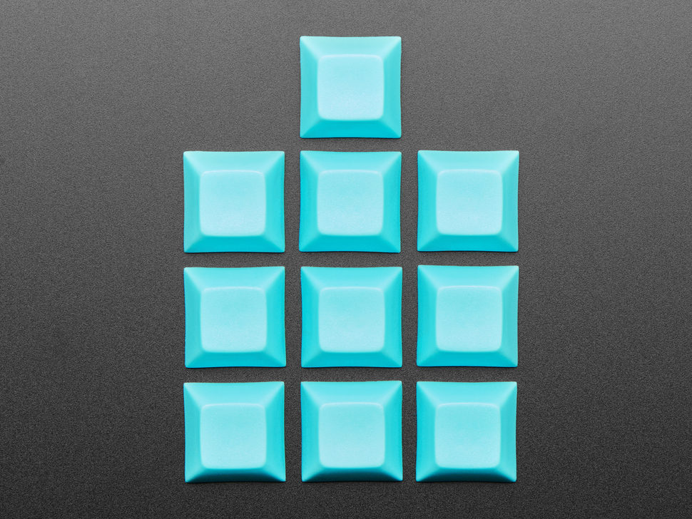 Top shot of 10 Light Blue plastic keycaps.
