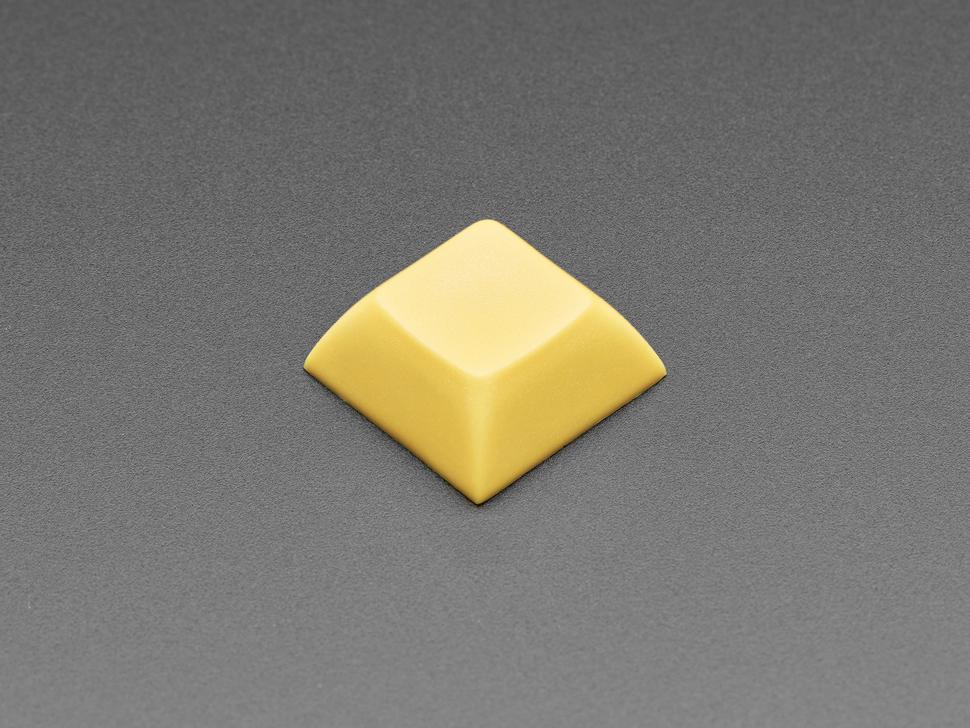 Single dark yellow plastic keycap.