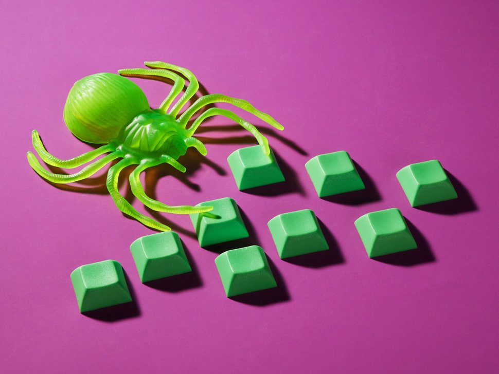 Group shot of DSA FLUORESCENT GREEN keycaps with a green spider on a dark pink background