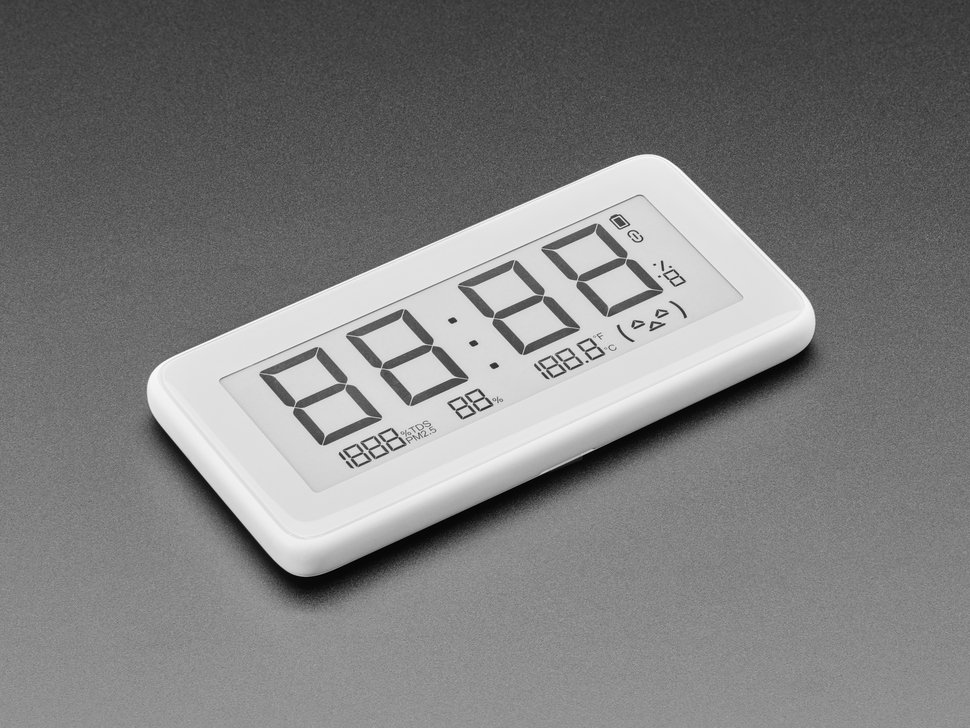 Angled shot of white rectangular digital clock with electronic ink display. It reads 88:88.