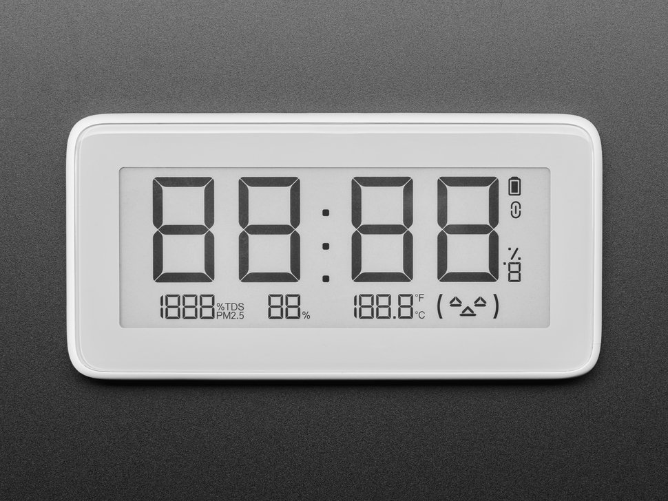 Top view of white rectangular digital clock with electronic ink display. It reads 88:88.