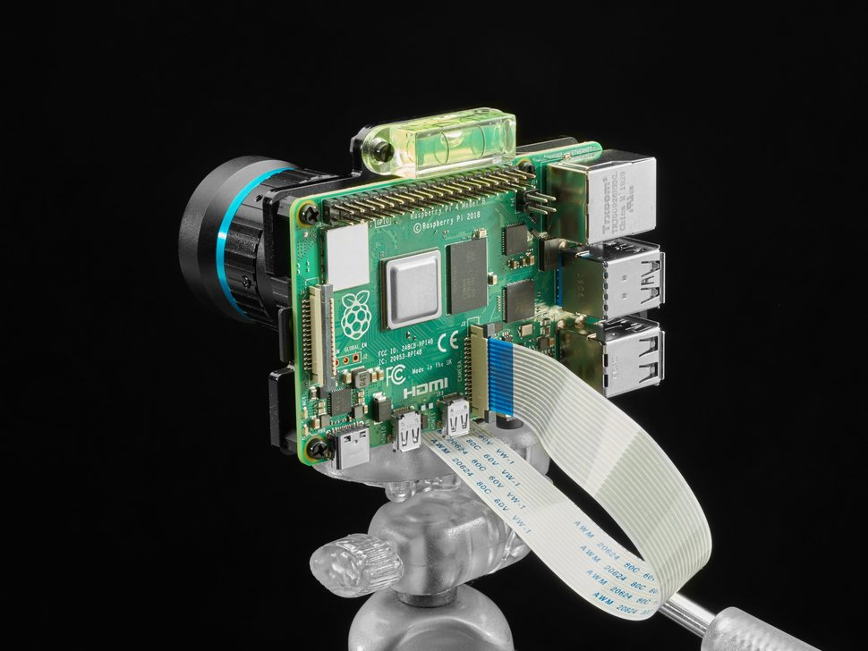 Assembled Raspberry Pi 4 with HQ camera on acrylic mounting plate on a flexible tripod.