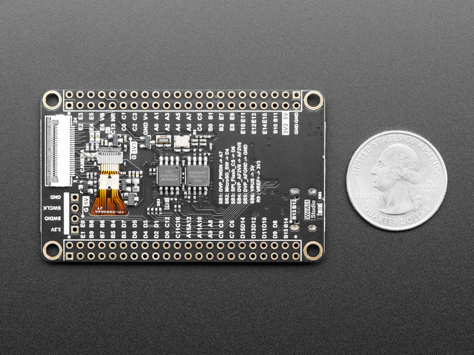 Bottom of dev board next to US quarter for scale.