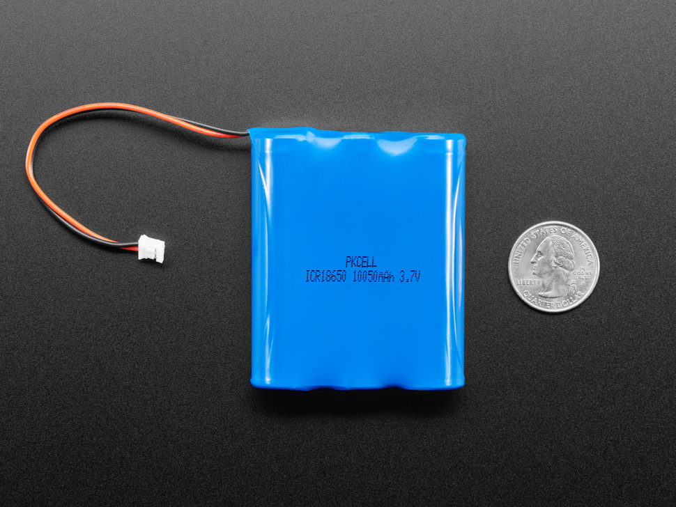 Bottom of blue rectangular lithium polymer battery with 2-pin JST connector next to US quarter for scale.