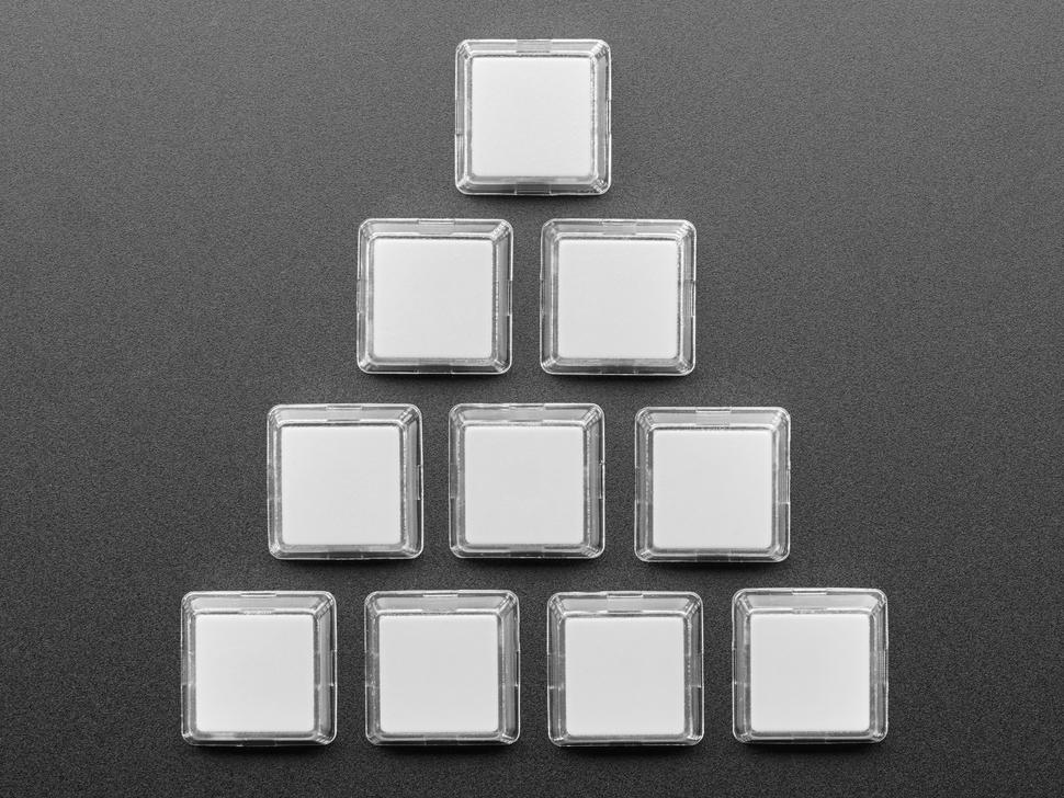 Top view of ten white plastic keycaps.