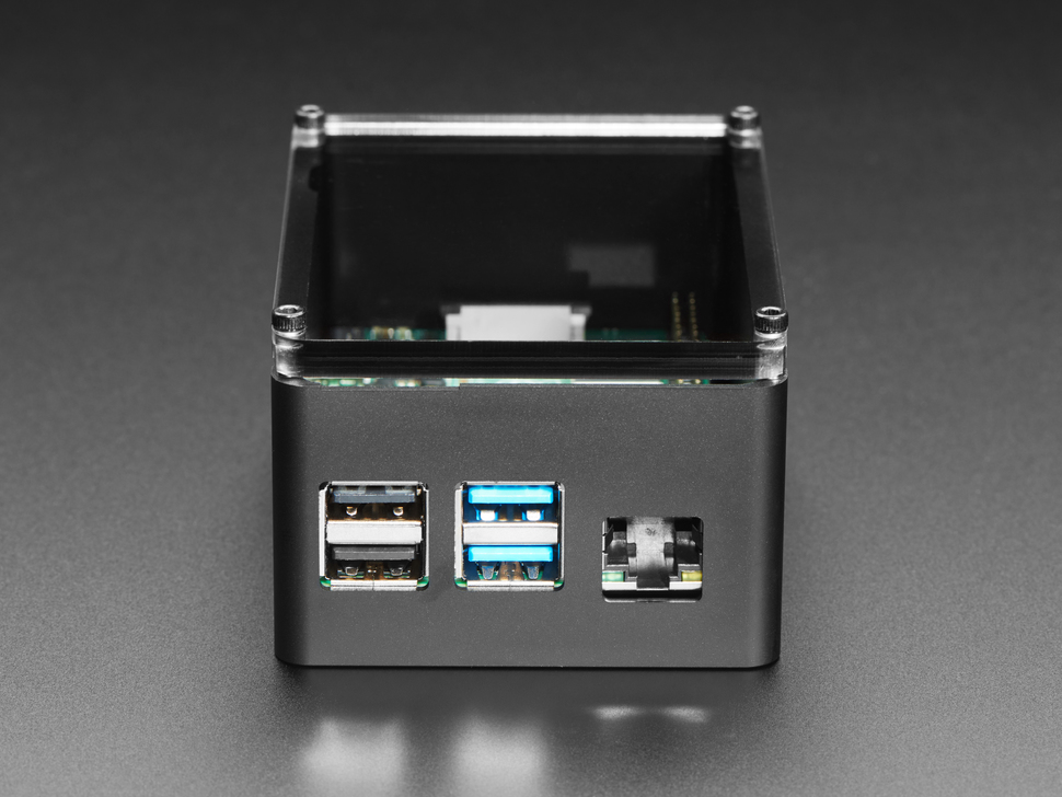 Side detail of Ethernet and USB ports on assembled black aluminum enclosure with a Raspberry Pi 4.