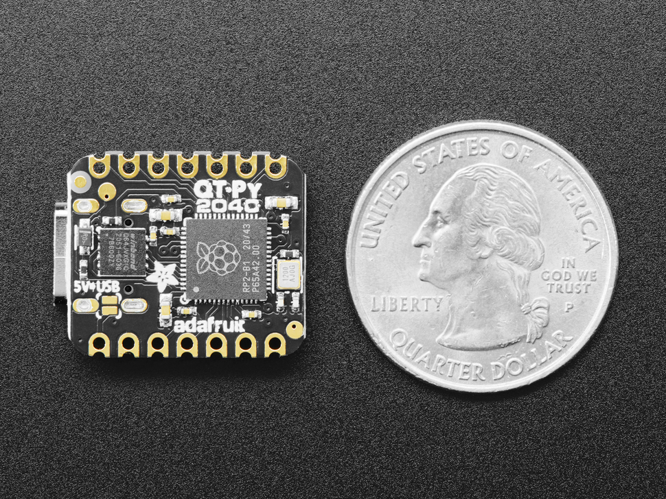Bottom of Adafruit QT Py RP2040 next to US quarter for scale.