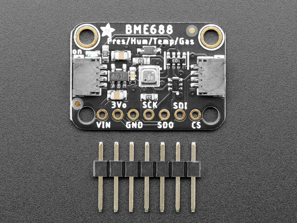 """Top view of BME688 sensor breakout with a piece of 0.1"""" male header."""
