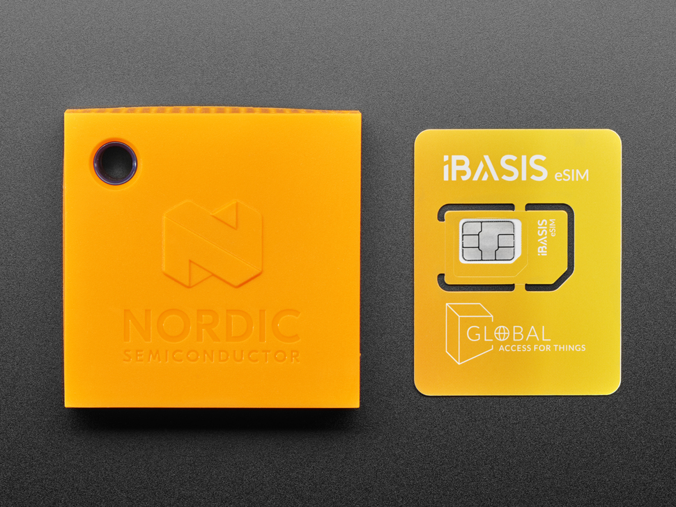 Top view of Nordic Thingy: 91 next to eSim card.
