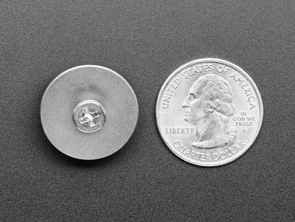 Back of rubber feet next to US quarter for scale.