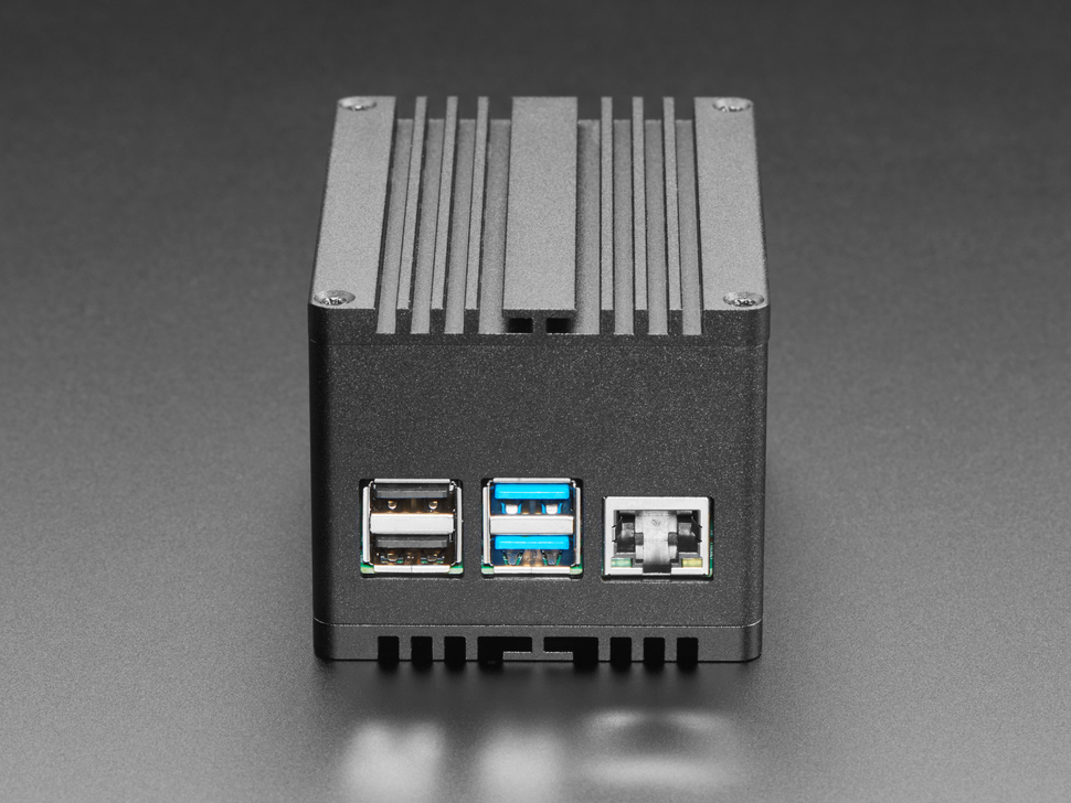 Side detail of black metal closure featuring the USB ports and Ethernet port.
