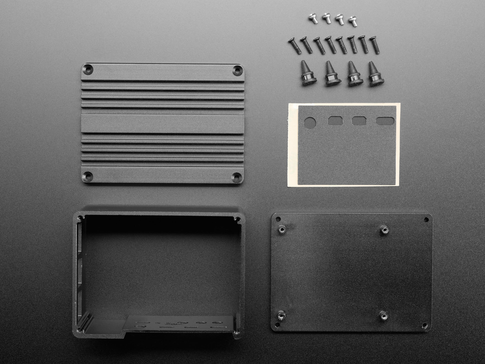 Top down shot of disassembled plates and hardware for aluminum Raspberry Pi 4 enclosure.