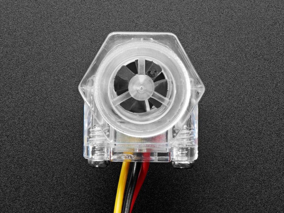 Close-up of clear turbine flow sensor.
