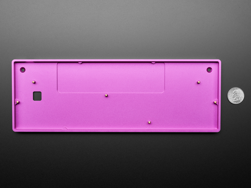Bottom of purple aluminum keyboard shell next to US quarter for scale.